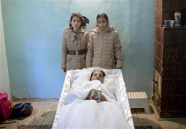 Two Of Maria Ion S Children 15 Year Old Denise And 11 Alexandra Posed Next To Her Coffin After They Had Requested A Souvenir Picture With Their